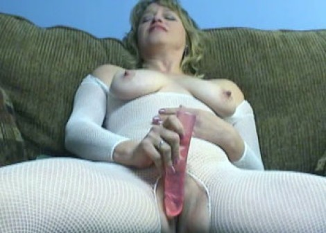 April fucks her big pink dildo